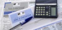 taxe d'habitation calculette et stylo - coproconseils
