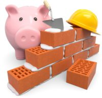 tirelire et briques de construction pour fonds de prévoyance travaux
